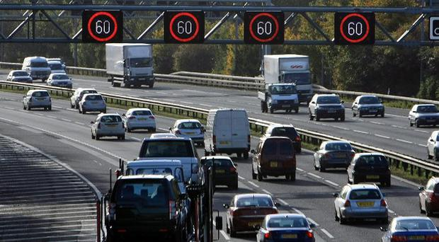 Traffic uses the hard shoulder of the M42 near Solihull as part of a congestion scheme