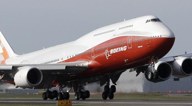 Boeing's 747-8 Intercontinental passenger plane takes off on its first flight at Paine Field in Everett, Washington (AP)