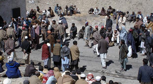 Mine workers and residents outside a coal mine after a explosion in Sorange near Quetta, Pakistan (AP)