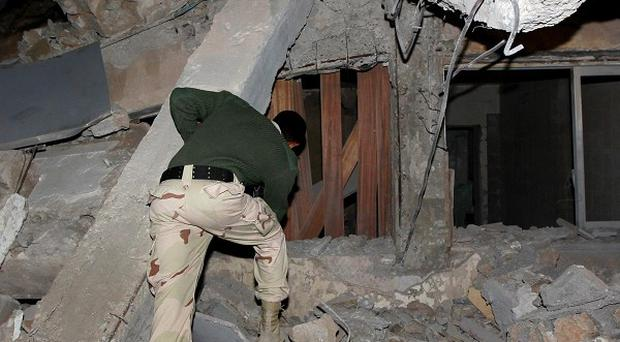 The building within Gaddafi's Tripoli complex was badly damaged by a missile (AP)