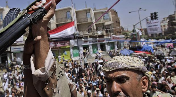 A Yemeni army officer has joined anti-government protestors demanding the resignation of President Ali Abdullah Saleh (AP)