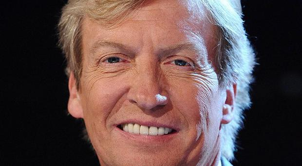 Nigel Lythgoe claimed Simon Cowell has destroyed the 'integrity' of The X Factor by putting on novelty acts who lack talent