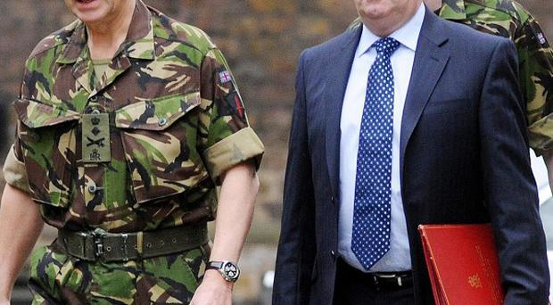 Liam Fox (right) has announced that around 2,000 civilian Ministry of Defence jobs will be cut
