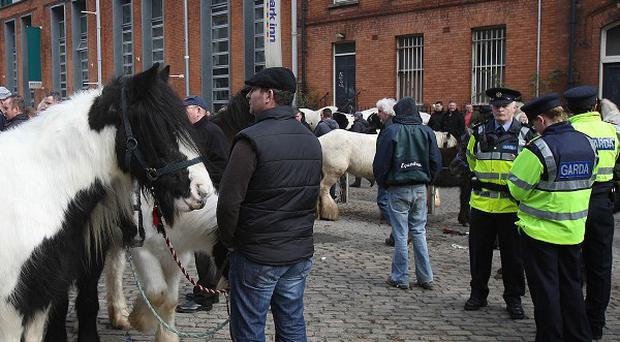 Gardai at the scene where two men were injured during an attack at Smithfield Horse Fair in Dublin