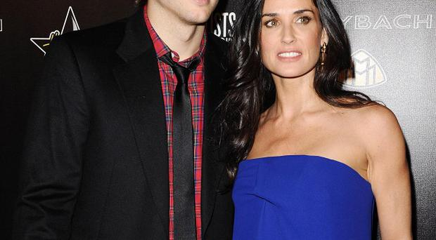 Ashton Kutcher and Demi Moore have dressed up as pigs in New York