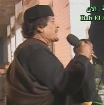 An image taken from Libyan state TV of Muammar Gaddafi addressing a large crown in Bab El Azizia (AP)