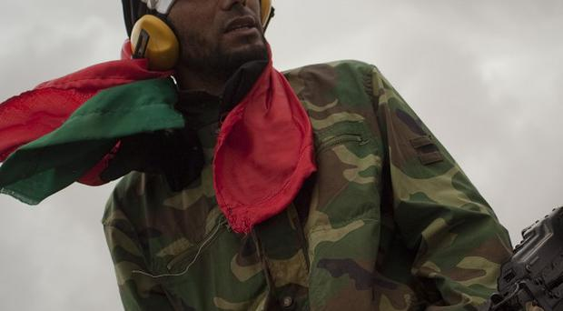 A Libyan rebel guards the frontline in the outskirts of the city of Ajdabiya, eastern Libya (AP)