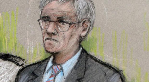 Court artist sketch of murder accused John Cooper in the dock at Swansea Crown Court