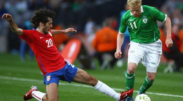 Stefan Babovic in action against the Republic of Ireland's Damien Duff at Croke Park two years ago