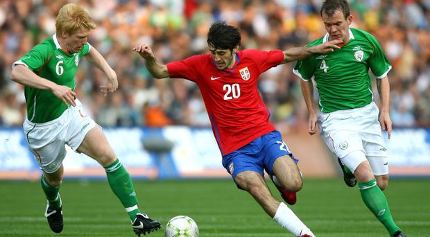 Paul McShane (L) and Glenn Whelan (R) of the Republic of Ireland compete for the ball against Stefan Babovic of Serbia during the International Friendly match between Republic of Ireland and Serbia at Croke Park on May 24, 2008 in Dublin