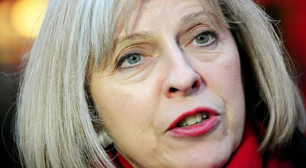 Theresa May says the number of foreign students and dependants coming to Britain could be cut by around 100,000 a year