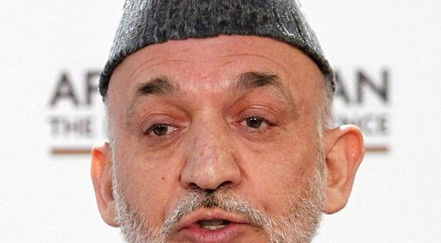 Afghan President Hamid Karzai says his security forces are taking over parts of the country from Nato troops