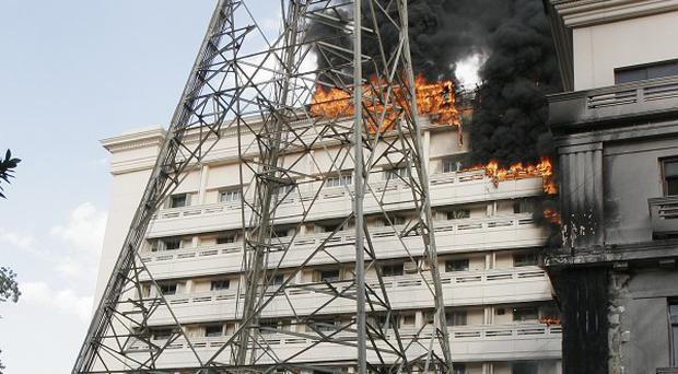 Flames engulf part of the Interior Ministry complex in Cairo (AP)