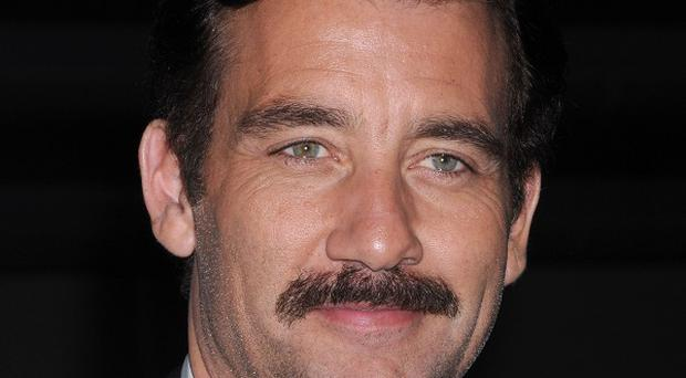 Clive Owen sported a moustache for the premiere of Trust