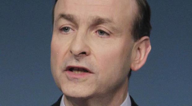 Fianna Fail leader Micheal Martin said former government minister Michael Lowry should consider his position at the Dail