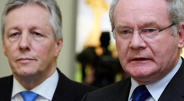 Northern Ireland First and Deputy First Ministers Peter Robinson and Martin McGuinness hailed their power-sharing administration