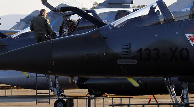 French Mirage 2000 jet fighters are prepared for a mission to Libya (AP)
