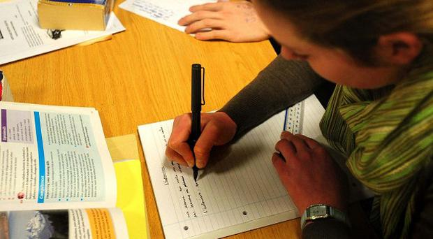 More than a fifth of people of working age in Northern Ireland have no qualifications, says Westminster committee