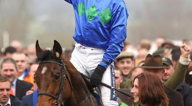 Ruby Walsh celebrates after winning the Champion Hurdle on Hurricane Fly as Gayle Carlisle, from Ballynahinch, who takes care of the horse on a daily basis enjoys the moment