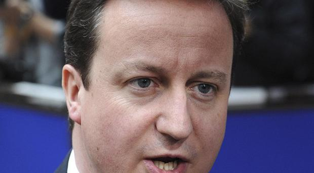 Prime Minister David Cameron has been accused of breaking the coalition's pledge to increase NHS funding (AP)