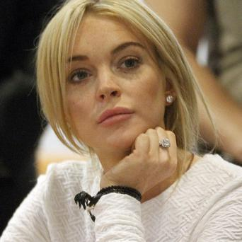 Lindsay Lohan has rejected a judge's offer to end a felony grand theft case early