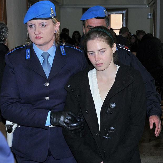 Amanda Knox arrives in Perugia's civil court for a hearing after her lawyers sought to block a film covering her case (AP)
