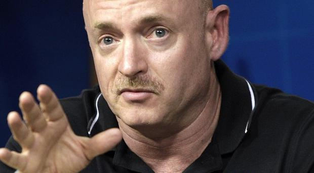 Endeavour commander Mark Kelly said his wounded congresswoman wife Gabrielle Giffords hopes to attend the launch (AP)