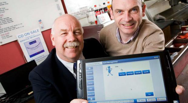 Pictured with the new Taskmaestro touch screen panel is: (L-R) Ian Murphy, Invest NI's Managing Director of Clients and Entrepreneurship and Gabriel Bradley, Taskmaestro.