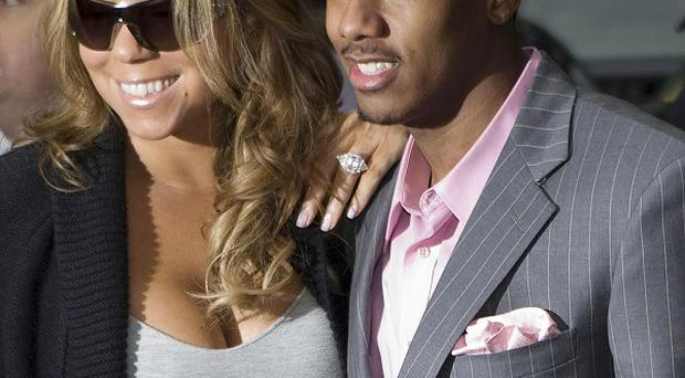 Nick Cannon thinks he might faint when Mariah Carey gives birth