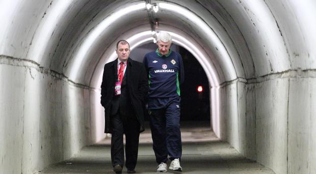 Northern Ireland boss Nigel Worthington and IFA chief executive Patrick Nelson trudge down the tunnel after defeat in Belgrade last night