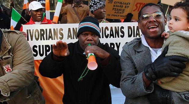 Members of the Ivory Coast community in an earlier protest outside the European Commission offices in Dublin over the situation in their country