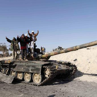 Libyan rebels celebrate in the city of Ajdabiya, south of Benghazi, eastern Libya (AP)