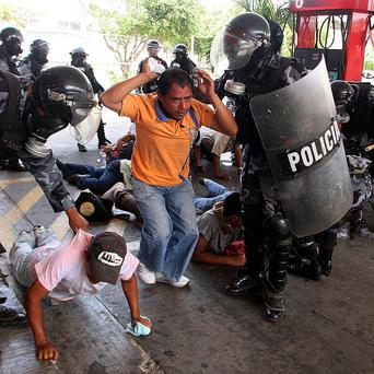 Demonstrators are arrested during a protest in Tegucigalpa, Honduras (AP)