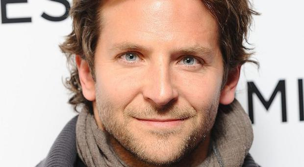 Bradley Cooper has to restrain himself when paparazzi are around