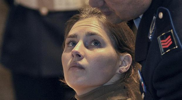 A key prosecution witness testifying in Amanda Knox's appeals trial has given conflicting versions of his story (AP)