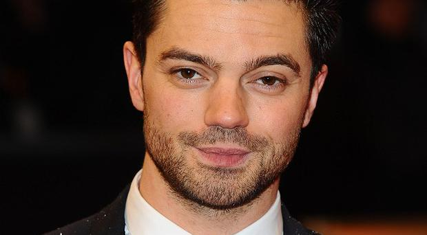 Dominic Cooper is being considered for the Bourne spin-off