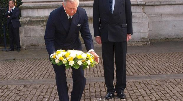 The Prince of Wales lays a wreath with New Zealand High Commissioner Derek Leask