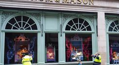 The clean-up operation begins at Fortnum and Mason in Piccadilly, London, after activists clashed with riot police