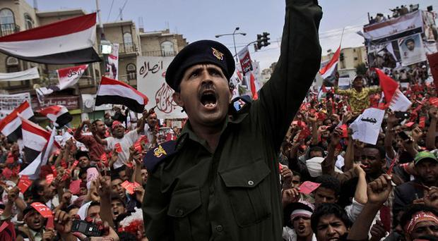 A Yemeni army officer shouts slogans along with anti-government protesters in Sanaa (AP)