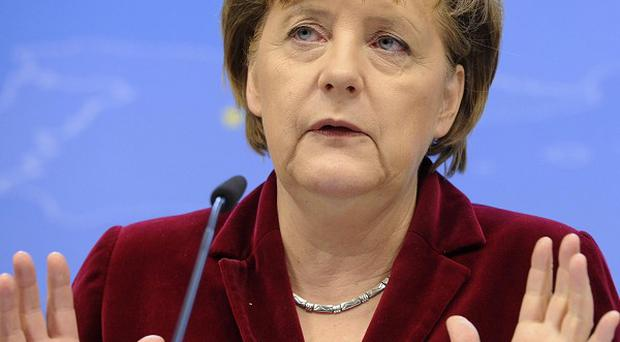 Chancellor Angela Merkel's party has suffered a defeat in a state election, according to a poll (AP)