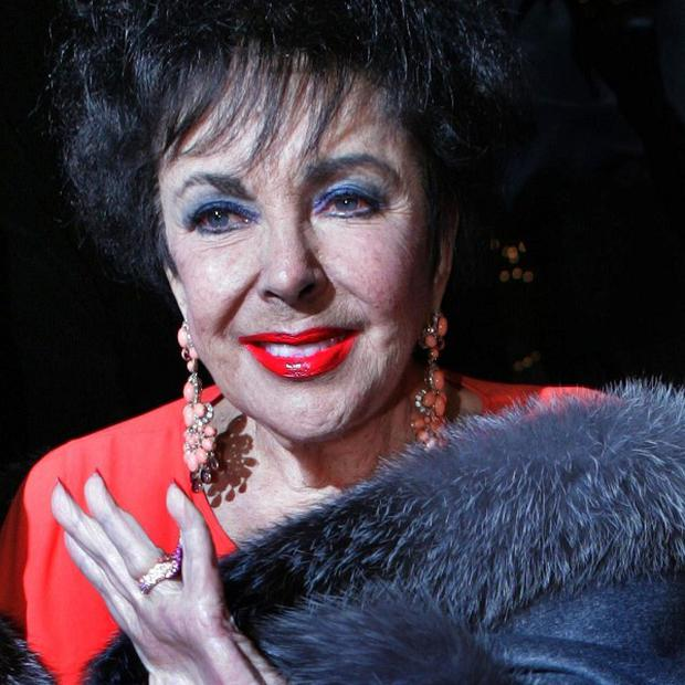Elizabeth Taylor's family mourned the screen legend in a brief private funeral service
