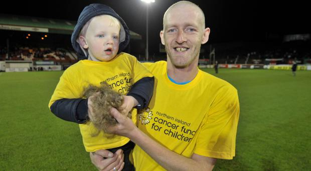 Chris Walker with his son Jaxon Roy Kelly, who died of meningitis yesterday