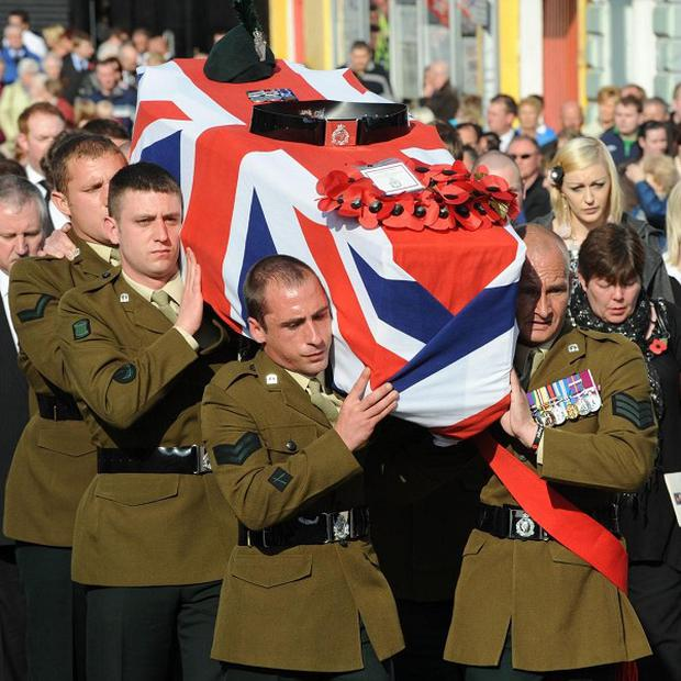The coffin of Lance Corporal Stephen McKee is carried during his funeral in Banbridge, Co Down