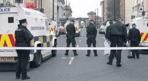 PSNI officers in Derry's Bishop Street following a controlled explosion on the bomb near the courthouse