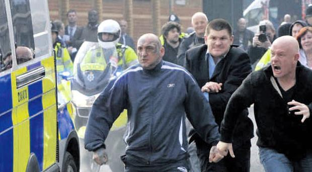 Members of the public attempt to attack the police van containing Christopher Halliwell as it leaves court yesterday