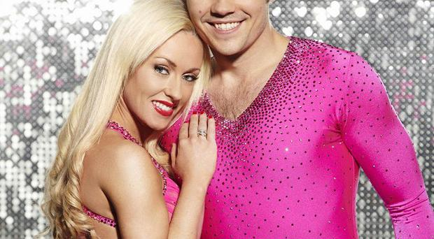 Sam Attwater lifted the Dancing On Ice trophy with partner Brianne Delcourt