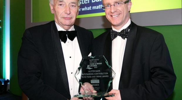 Billy O'Kane (left) from O'Kane Poultry has won the 2011 Ulster Bank award for outstanding contribution to Northern Ireland food and drink. He received his awards from Ian Jordan, Ulster Bank