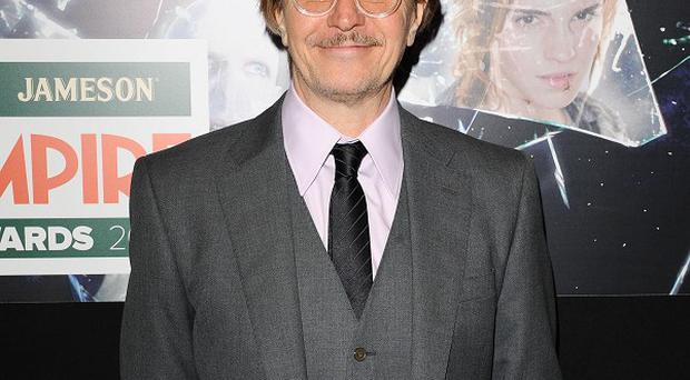 Gary Oldman arrives at the Empire Film Awards at the Grosvenor House Hotel in London