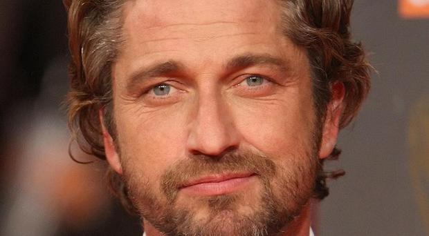 Gerard Butler is apparently being considered for a role in the new Professionals film