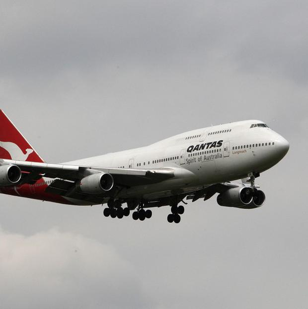 Qantas is to cut capacity growth, retire aircraft early and shed managers in response to natural disasters in key destinations